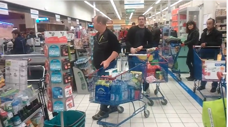 There is the queue in a supermarket